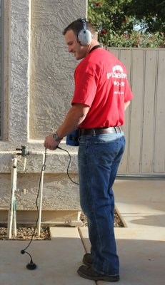 leak detection technician inpecting for leaks